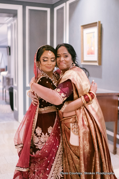 Bride giving hug to her mother