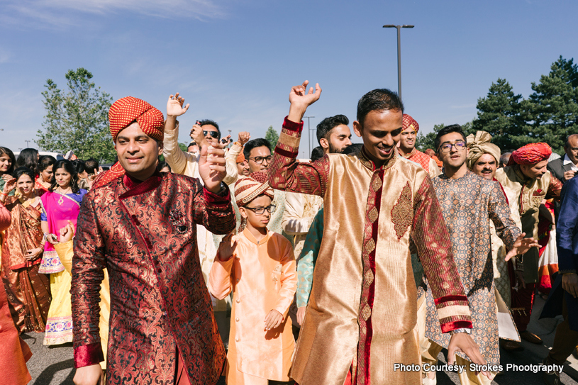 Friends and family Dancing at the Wedding Baraat