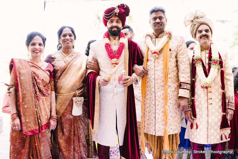 Indian groom entering wedding hall