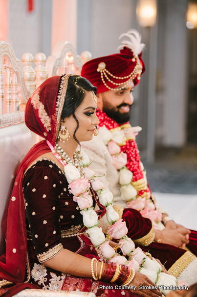 Indian Couple posing in Wedding Chauri