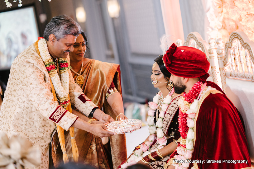 Indian grooms parents with indian couple