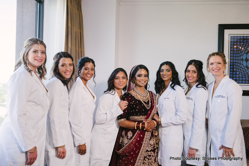 Indian bride posing with her friends