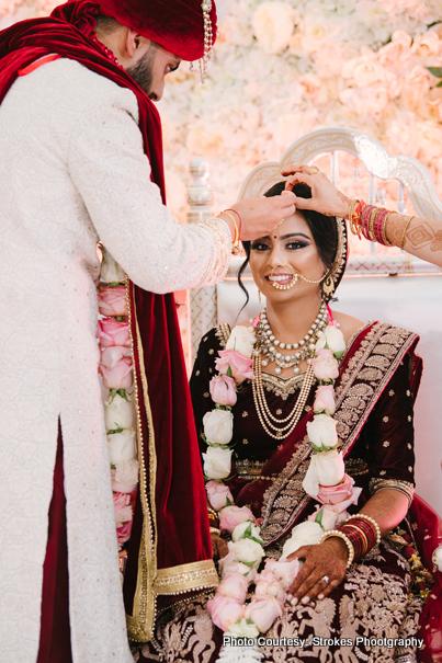 Groom applying Sindoor to Bride