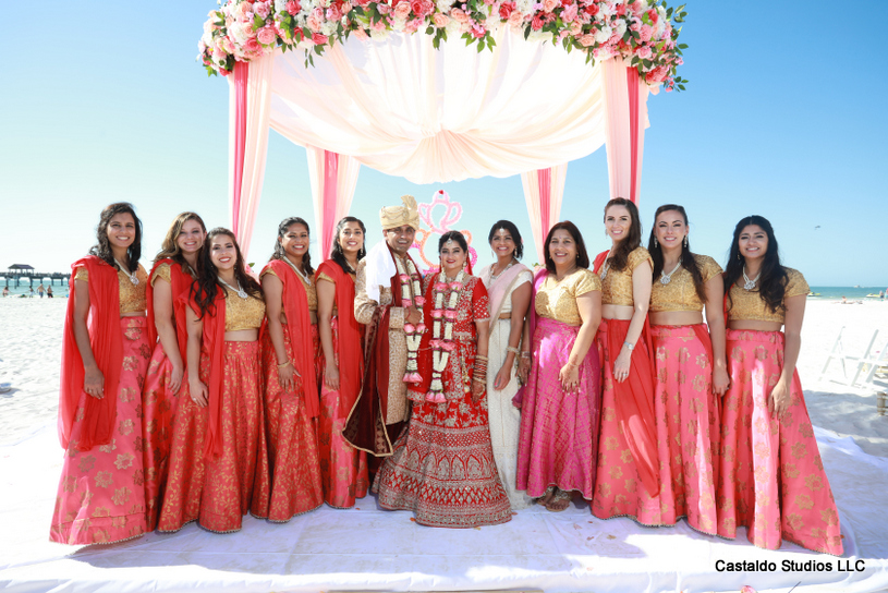 Indian Couple Posing With Bridesmaids