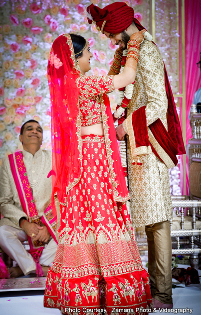 Bride exchanging Garland