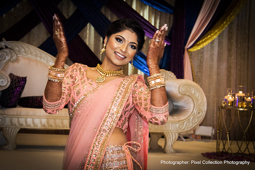Glamorous indian bride dancing photography