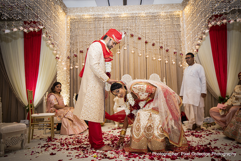 Bride Touching Indian groom's Feet
