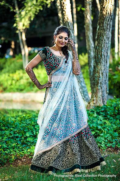 Glamorous indian bride posing outdoors