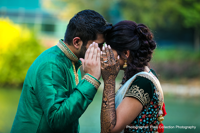 Lovely capture of Indian bride and groom holding each other