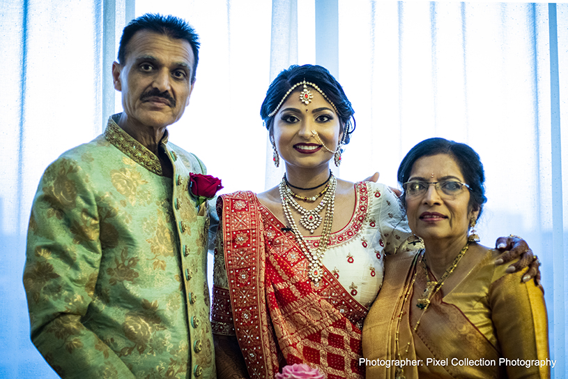 Indian Bride with Family posing for a photo
