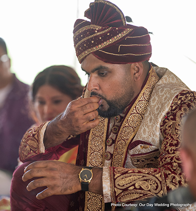 Groom Eating Sweet in middle of ceremony