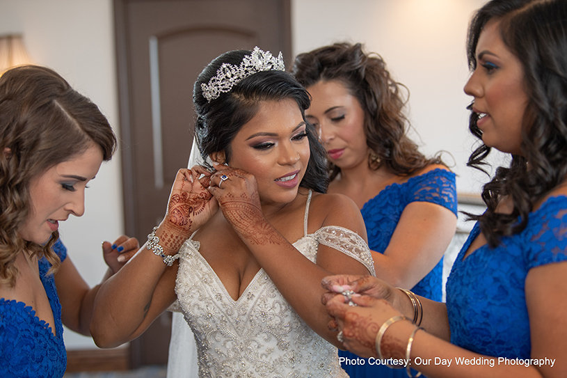 Bridesmaids Helping Bride to get ready for her big Day