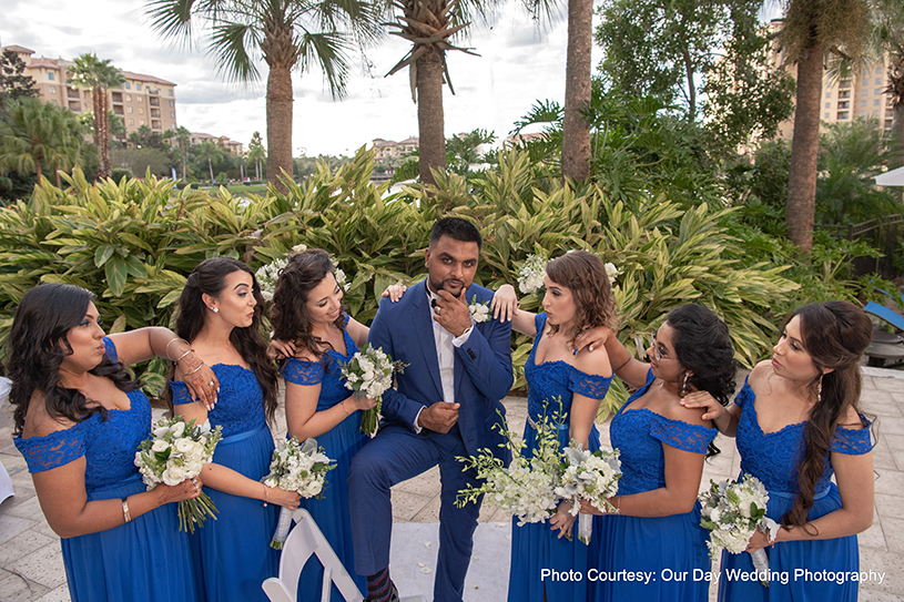 Indian Groom Posing With Bridesmaids