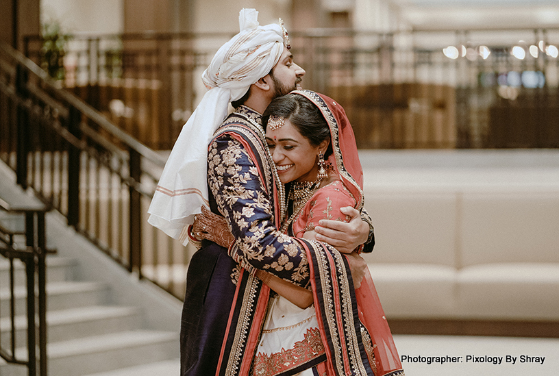Indian Couple hugging eachother