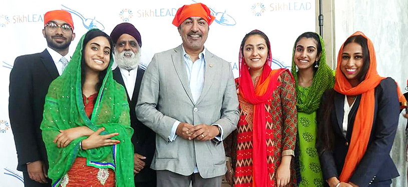Democratic Congressman Ami Bera of California is flanked by SikhLEAD interns and leaders of SALDEF at the fourth annual Langar on Capitol Hill