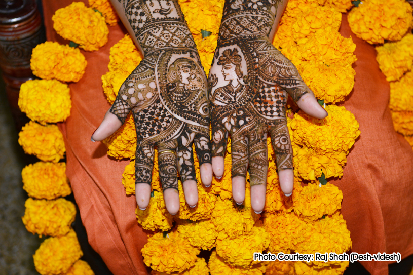 henna is applied on the bride's hands and feet in anticipation of the wedding ceremony