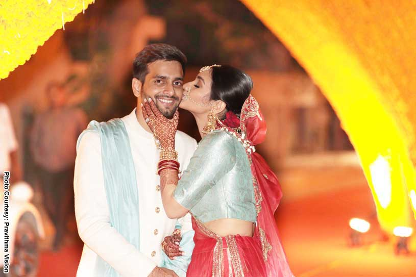 Marvellous capture of Bride kissing Indian Groom