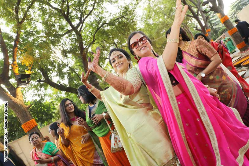 Groom's mother and Bride's Mother dancing at the Baraat