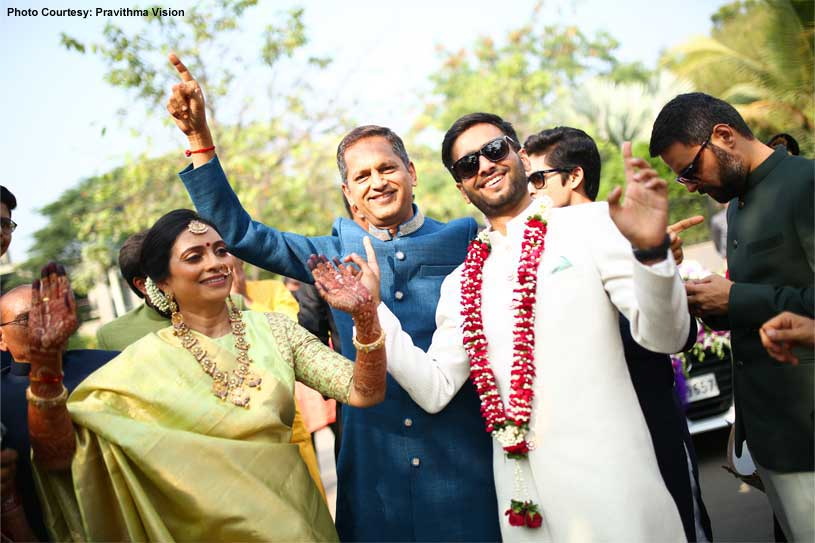 Indian Groom and parents Dancing at the Baraat