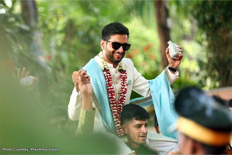 Friend Lifting Groom at the Baraat