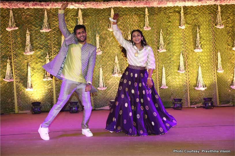 Indian Couple Dancing at the sangeet ceremony
