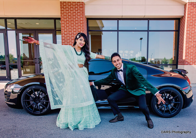 Indian bride and Groom posing Infront of Supercar