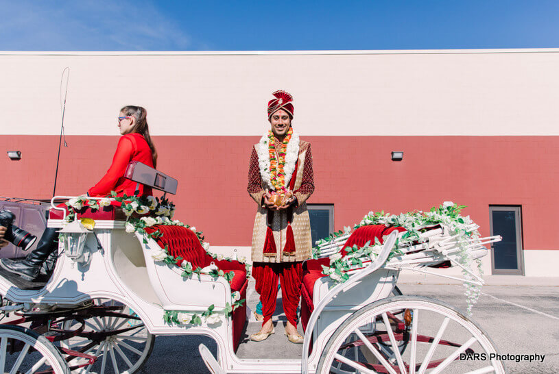 Indian Groom Arriving at the Baraat in Carriage by Blue Ribbon Carriages