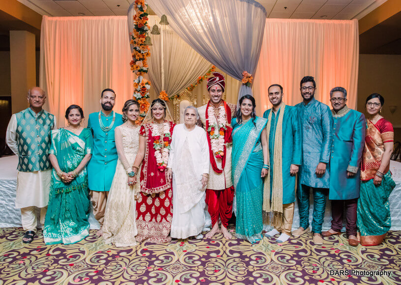 Indian Couple Posing With Family