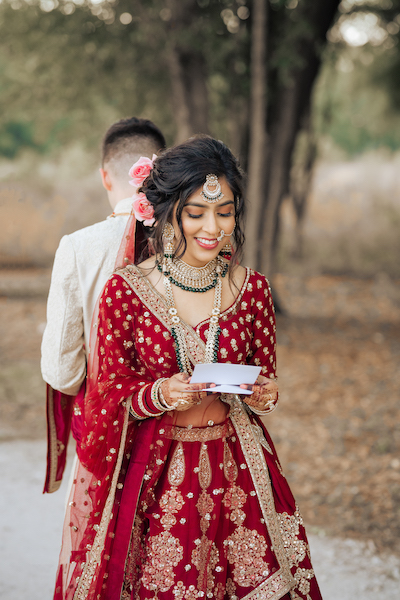 Indian bride reading Love letter given by Indian groom
