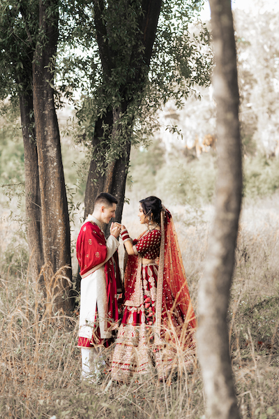 Indian brida and groom holding each other's hand