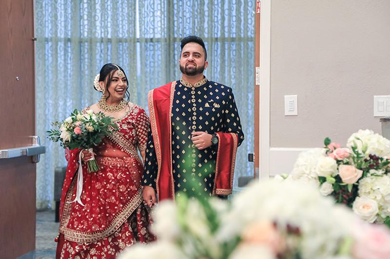 Indian couple entering wedding venue