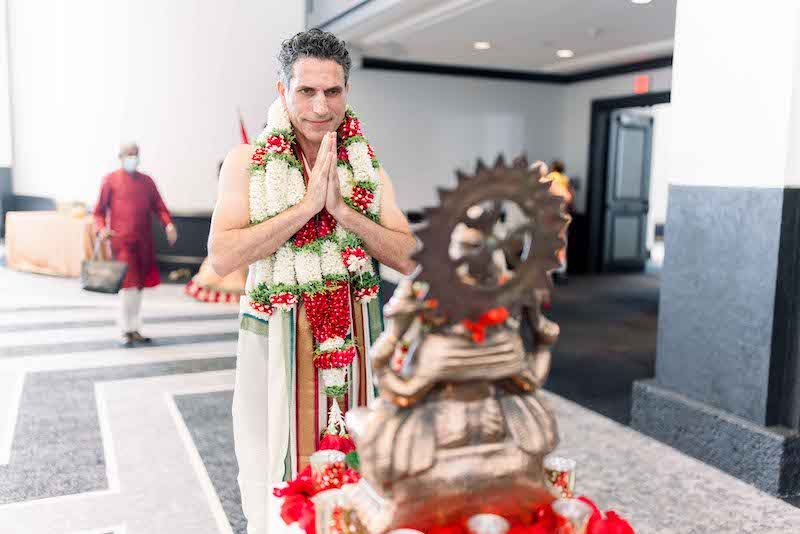 Indian Groom Holding hands in front of God