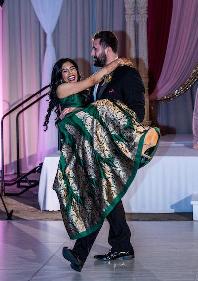 Couple having fun at wedding reception