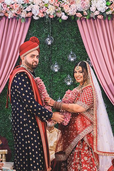Indian bride wears garland to Groom