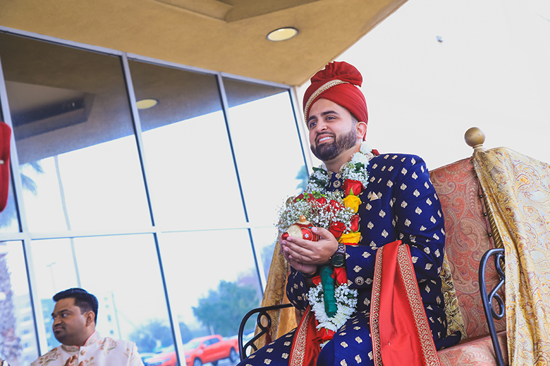 Indian groom entering by horse carriage