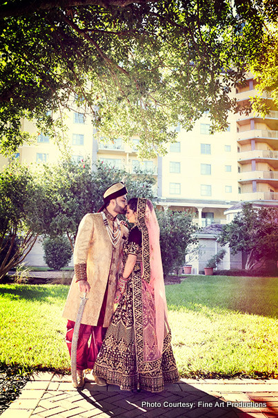 Indian groom Kissing Forehead of Indian Bride