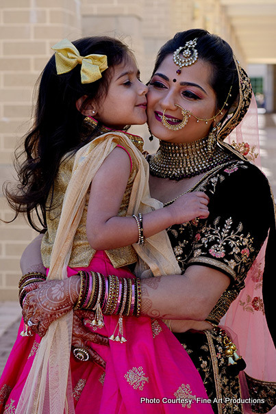 Cute Girl Kissing Indian Bride