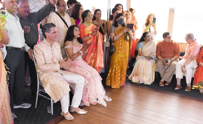 Indian couple cheering for the Sangeet performance