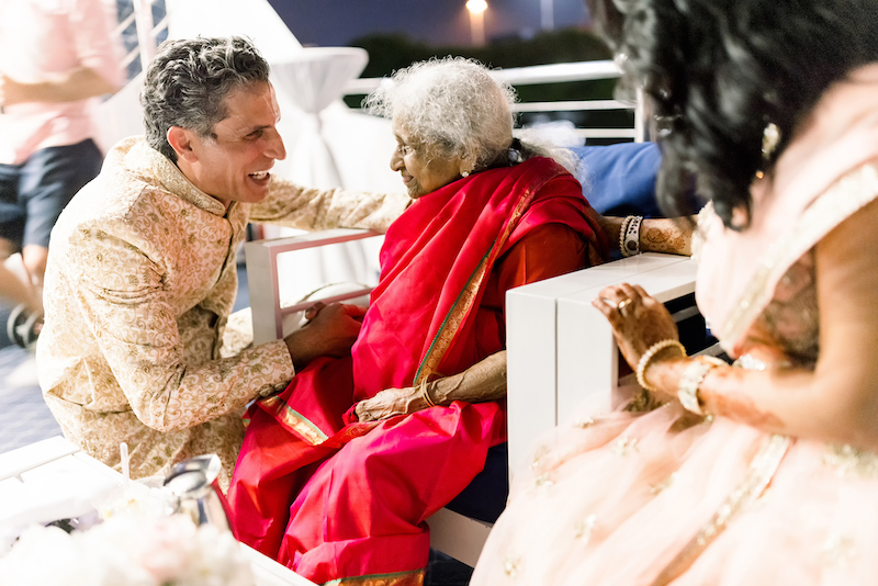 Indian groom taking blessings from Grand mother