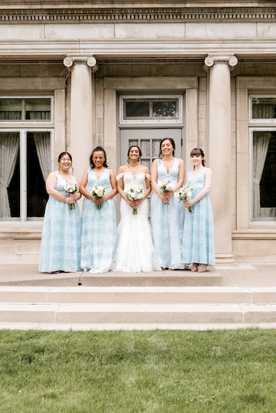 Indian bride and bridesmaid with wedding bouquet