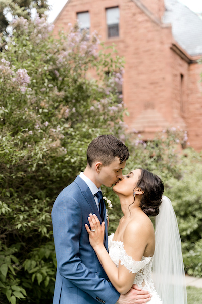 Wedding couple kissing to eachother