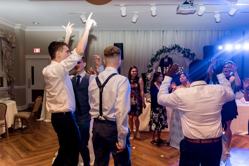 Fusion wedding guest enjoying dj Party