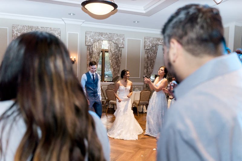 Fusion wedding couple performing their dance in reception ceremony