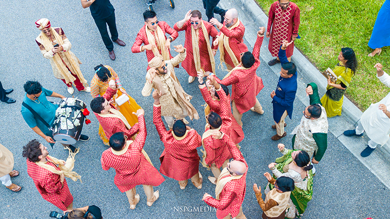 Groom dancing with friends and family In Wedding Baraat