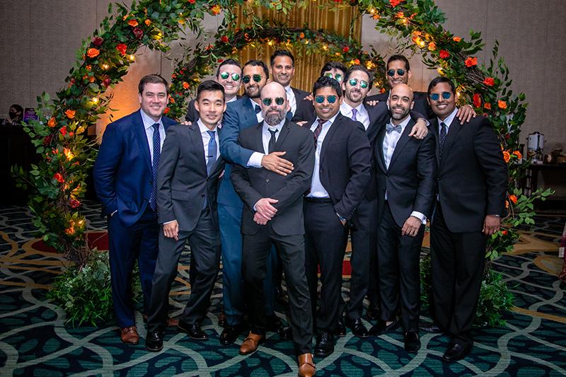 Groom posing with groomsmen at Wedding reception