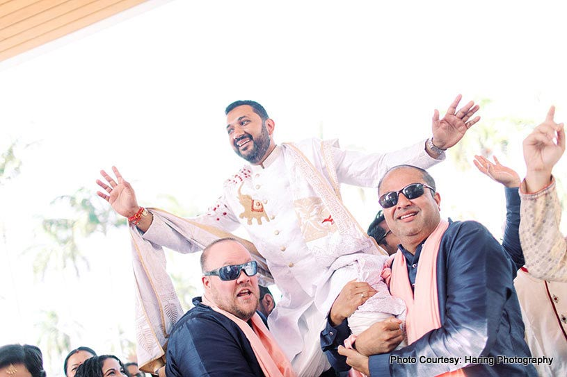 Friends carrying indian groom at the Wedding venue