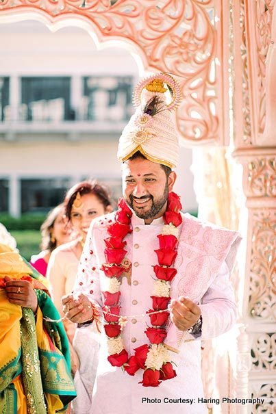 Indian Groom holds Mangalsutra In hand