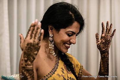 Indian bride Blushing at the Mehndi Ceremony