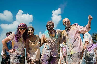 Friends Having fun at Holi party