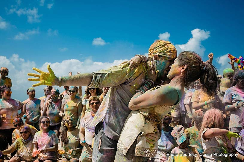 Couple dancing at Holi Party
